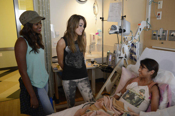 Amber Holcomb and Angie Miller visit Children's Hospital Los Angeles. Neither contestant was sent home this week.