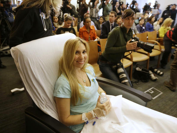 Heather Abbott of Newport, R.I., is wheeled into a news conference at Brigham and Women's Hospital in Boston. Abbott underwent a below-the-knee amputation following injuries she sustained at the Boston Marathon bombings.