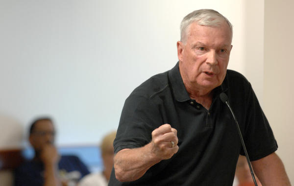 Digger Phelps addressing the South Bend School Board on last July.