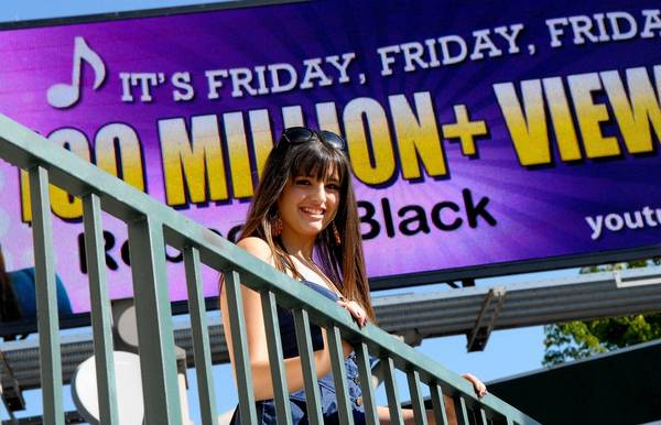 "Rebecca Black, whose song ""Friday"" became a viral hit on YouTube, unveils a billboard in April 2011."