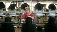 A jump in business inventories lifted economic growth. Debbie Steinmetz stacks hats at the Bollman Hat Co. in Adamstown, Pa.