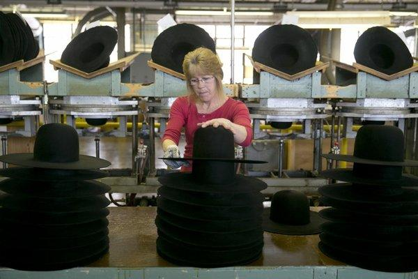 Debbie Steinmetz stacks hats at the Bollman Hat Co. in Adamstown, Pa. A jump in business inventories lifted economic growth.