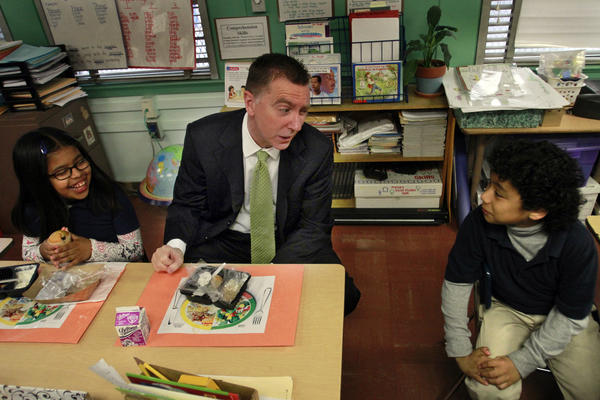 L.A. Unified Supt. John Deasy talks with students at Figueroa Street Elementary School, with breakfast in front of them.