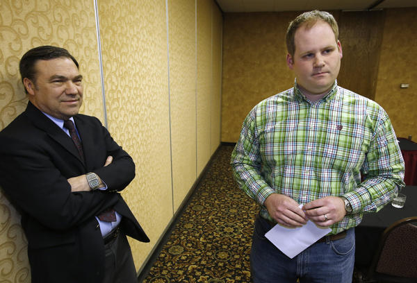 Steve Kaiser, acting public relations director, left, and A.J. Munger, director of new business development, both with Northern Beef Packers, take questions following Thursday's news conference announcing the layoff of workers. American News Photo by John Davis