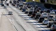 A controversial monthly fee tied to Los Angeles County's new toll lane system was suspended Thursday after a lengthy discussion and divided vote by the Metropolitan Transportation Authority board.