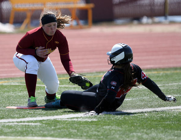 Northern State's Jordin Novak, left, tags out St. Cloud State's Megan Lehnen at third base on Thursday at Swisher Field during an NSIC doubleheader.