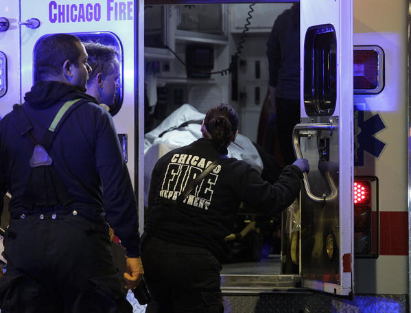 A shooting victim is loaded into an ambulance in the 300 block of North Cicero Avenue in Chicago on Friday, April 26, 2013. (Terrence Antonio James/Chicago Tribune)