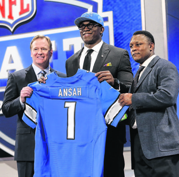 BYU's Ezekiel Ansah stands with NFL Commissioner Roger Goodell, left, and Lions legend Barry Sanders after being selected fifth overall by Detroit in the first round of the NFL draft Thursday.