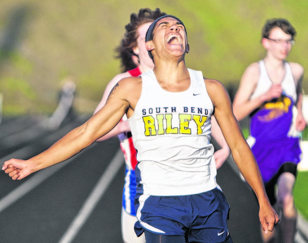 Riley's Bruce Bragg Jr. celebrates as he wins the boys mile event during the city meet Thursday at St. Joseph High School.