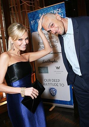 Kristin Chenoweth checks out Hank Azaria's shaved head.