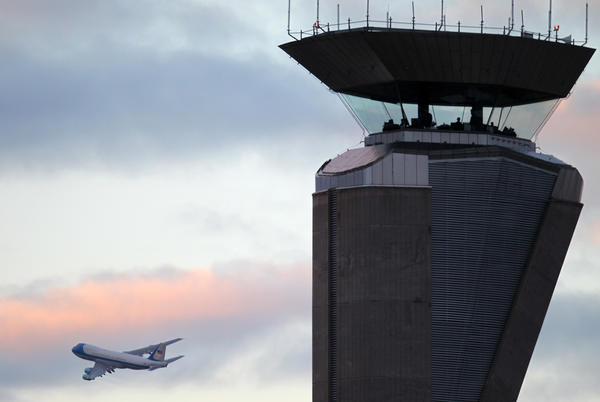 Air Force One flies past the North Airfield traffic control tower as it departs from O'Hare International Airport in Chicago. (File/Anthony Souffle/Chicago Tribune)