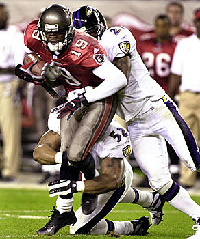 Tampa Bay's Keyshawn Johnson (19) is tackled by Ravens Ray Lewis (52) and Chris McAlister (21) in the first quarter.