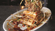 "Hash House A Go Go opened touting ""urban-farm décor"" and over-the-top portions of something called ""twisted farm food."""