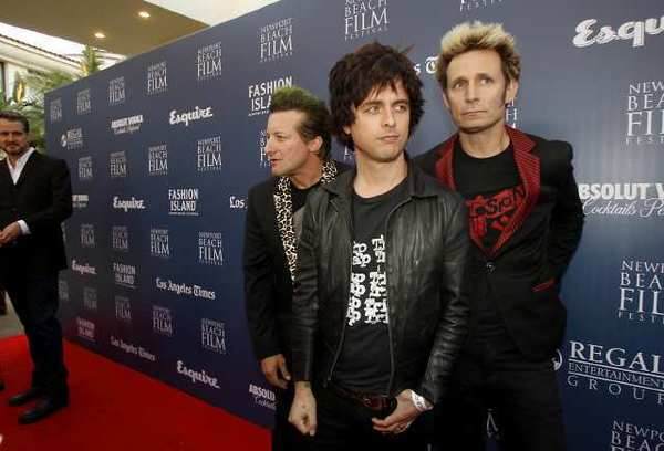 "Tre Cool, Billie Joe Armstrong and Mike Dirnt, left to right, of the punk band Green Day, arrive on the red carpet for the West Coast premiere of ""Broadway Idiot"" during opening night of the 2013 Newport Beach Film Festival on Thursday. The movie documents how the band's album ""American Idiot"" became a broadway musical."