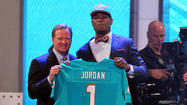 Here is an easy way to examine how the Miami Dolphins did in day one of the 2013 NFL draft.