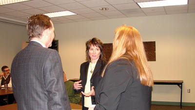 Pennsylvania Department of General Services Secretary Sheri Phillips speaking to Ed and Heidi Sroka before a meeting Friday hosted by the Somerset County Chamber of Commerce.