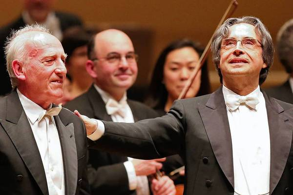 Italian pianist Maurizio Pollini, left, stands for applause along with conductor Riccardo Muti, prior to intermission during a performance Thursday at the Symphony Center in Chicago.