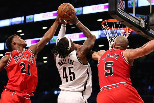Brooklyn Nets' Gerald Wallace is stopped by Chicago Bulls Jimmy Butler and Carlos Boozer.