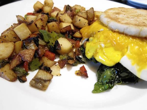 Slagel Farm Sausage Breakfast Sandwich, English muffin, aged cheddar, fried egg, spinach, home fries, $12. Phil Vettel/Chicago Tribune.