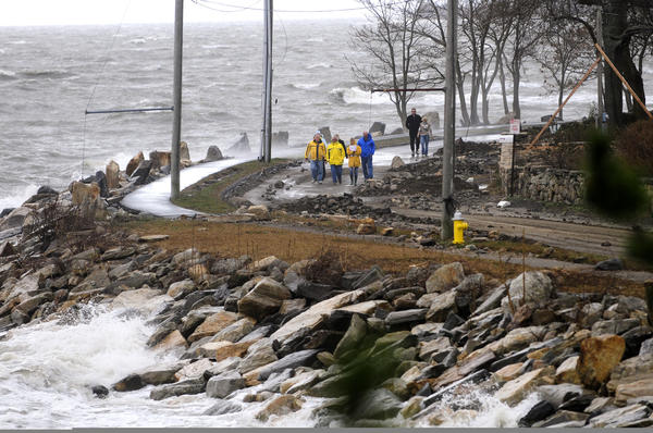 Westport residents walk along the Hillspoint Road section of town that was washed out by Sandy.