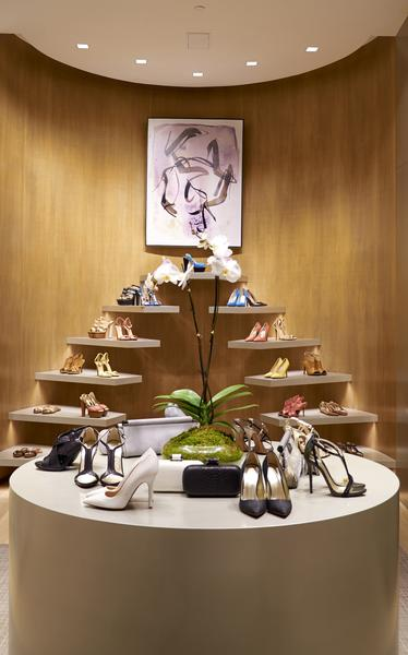 A floating staircase display shows off the store's shoe collection. The line targets care