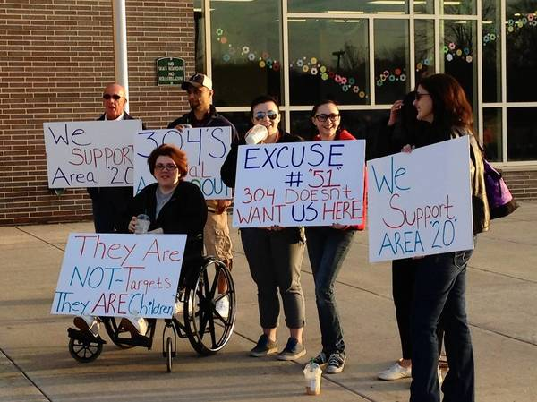 Residents from the Batavia Highlands neighborhood protest outside the District 304 school board meeting on April 22. The board voted to move those students from Williamsburg Elementary to Western Avenue School.