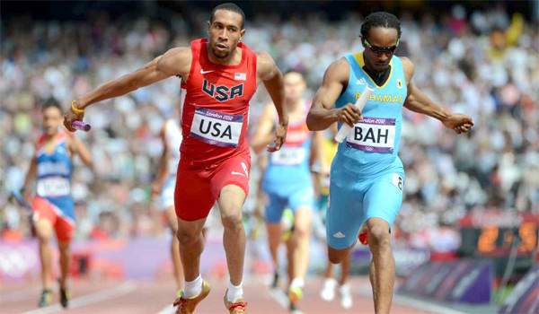 Bryshon Nellum and the Bahamas' Chris Brown compete in a men's 4X400m relay heats during the London 2012 Olympic Games on August 9, 2012.
