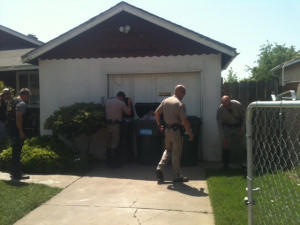 California Highway Patrol officers search for a suspect in Sacramento.