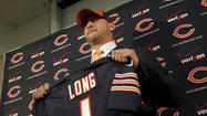 Kyle Long's path to the podium at Halas Hall on Friday was anything but ordinary.