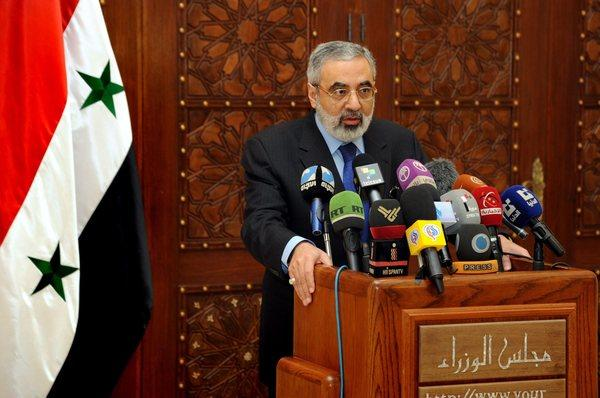 Syrian Information Minister Omran Zoubi, seen at a news conference last month, has denied allegations that Syria used chemical weapons in its fight against rebels seeking the overthrow of President Bashar Assad.