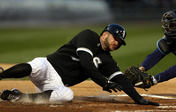 Chicago White Sox' Jeff Keppinger scores on Paul Konerko's RBI single Thursday.