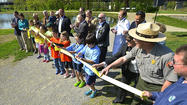 Williamsport Elementary School fourth-graders helped National Park Service officials open two new educational trails Friday morning at the C&O Canal National Historical Park in Williamsport.