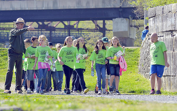 National Park Service district ranger, Curt Gaul, leads a group of Williamsport Elementary School students on a hike on C&O Canal Friday. Officials opened the first Track Trail with a ceremony at the canal.