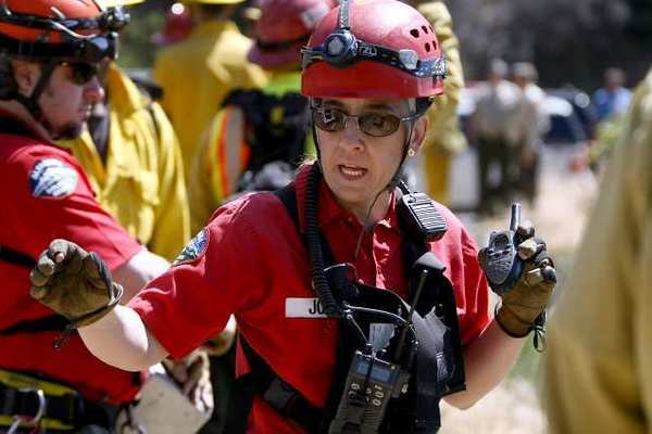 "Altadena Mountain Rescue Team member Alexia Joens directs the rope handlers as they bring up a ""victim"" during multi-agency ""over-the-side"" high angle, technical rescue exercise on Angeles Crest Highway on Friday, April 26, 2013. About 100 personnel from different local agencies participated, including the Los Angeles County Sheriff's Montrose Search & Rescue Team, Altadena SAR, L.A. County firefighters from La Canada Flintridge and Pico Rivera along with Air Rescue 5, and the U.S. Forest Service."