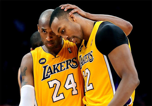 Lakers guard Kobe Bryant (24) hugs center Dwight Howard after Howard made one of two free throws late in a game against the Memphis Grizzlies earlier this month.