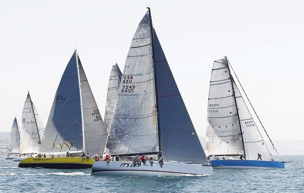 From left, crews of the Taxi Dancer, It's OK and Medicine Man take off in the Maxi Class division of the 66th annual 2013 Lexus Newport to Ensenada Yacht Race from Newport Harbor on Friday.