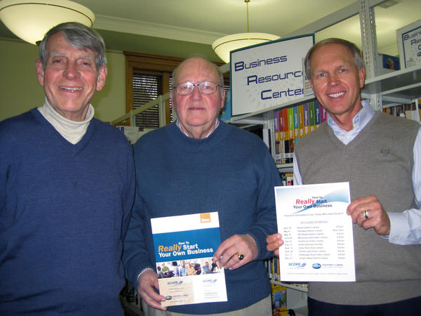 Bill Hicklen and Chris Smith, both of the Service Core of Retired Executives, join Tom Erhart, entrepreneurship director for the Northern Lakes Economic Alliance, to invite those with a business idea to participate in one of a series of workshops about how to launch a new business.