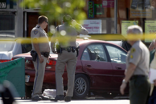 Los Angeles County sheriff's deputies fatally shot a motorist in an Athens area strip mall Friday afternoon after his vehicle allegedly struck an officer.