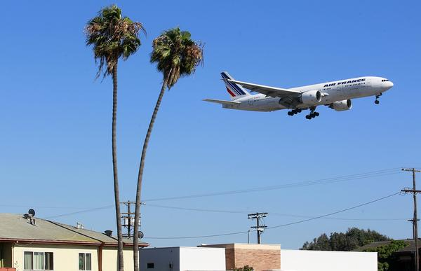 In a view from Sepulveda Boulevard in Westchester, a plane heads to the north runway at LAX.