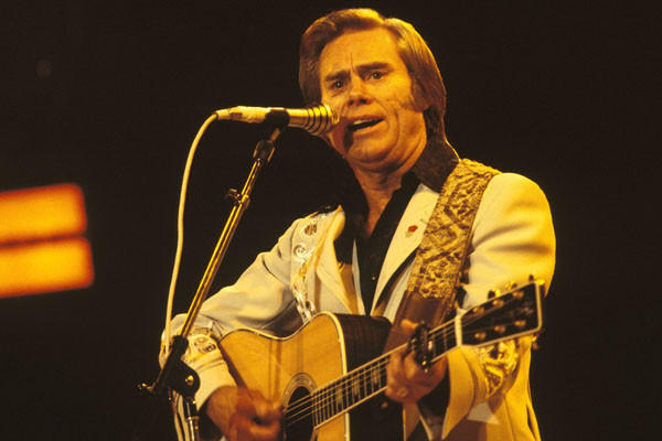 George Jones performs on stage at the Country Music Festival held at Wembley Arena, London in April 1981.