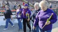 The red, white and blue color scheme newly representing the Hagerstown Suns gave way to a deep shade of purple Friday at Municipal Stadium, where cancer survivors sporting the color took a celebratory lap around the bases before the game.