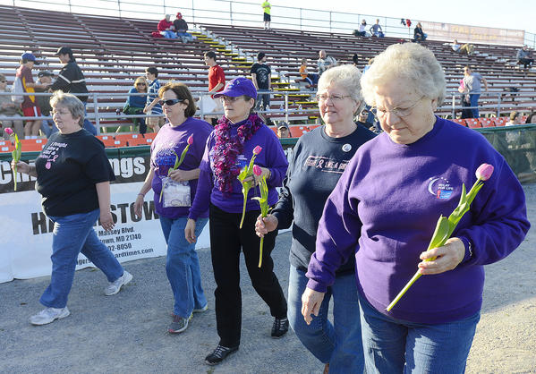 Walking a lap at Municipal Stadium Friday night prior to the Suns baseball game with Hickory are cancer survivors, from left, Sue Easterday of Hagerstown, Crystal Ancarrow of Smithsburg, Melissa Wheatcraft of Hagerstown, Alethea Wyand of Boonsboro, and Marcia Bortz of Hagerstown.