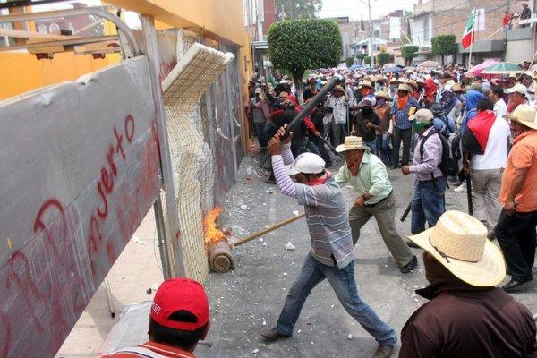 Demonstrators attack the Democratic Revolution Party, or PRD, headquarters in Chilpancingo, Mexico, on April 24, 2013. Thousands of teachers and activists participated in a riot against an education reform approved by the Mexican government.