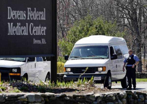 A guard stands near the entrance to the Devens Federal Medical Center at Ft. Devens, near Boston, where bombing suspect Dzhokhar Tsarnaev has been transferred.