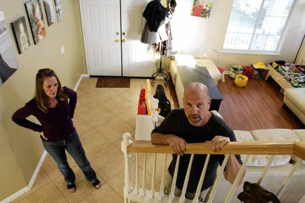 "Because of a prior foreclosure, Michele and Russell Poland turned to a subprime mortgage to buy their current home. ""It was expensive, but we think it's worth it,"" Russ Poland said."