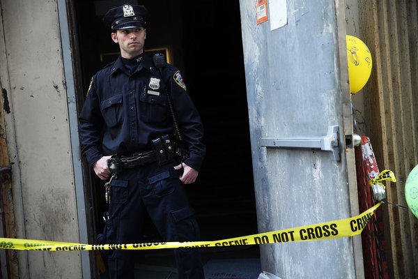 A police officer guards the site in Lower Manhattan where a piece of debris, believed to be from one of the planes destroyed on Sept. 11, 2001, was found wedged between two buildings.