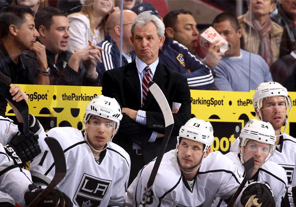 Kings Coach Darryl Sutter watches from the bench during a game against the Phoenix Coyotes.