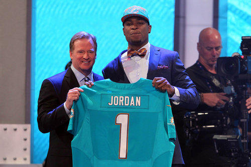 Apr 25, 2013; New York, NY, USA; NFL commissioner Roger Goodell introduces defensive end Dion Jordan (Oregon) as the third overall pick of the 2013 NFL Draft by the Miami Dolphins at Radio City Music Hall. Mandatory Credit: Brad Penner-USA TODAY Sports ORG XMIT: USATSI-126772