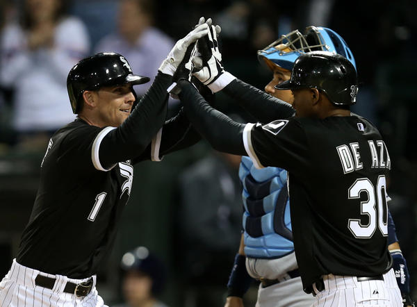 White Sox second baseman Tyler Greene, left, celebrates with Alejandro De Aza after Greene hit a two-run homer in the fifth inning. (Chris Sweda/Tribune photo)