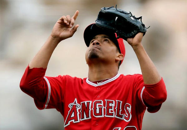 Angels closer Ernesto Frieri points skyward after earning a save against the Houston Astros.